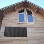 Pignon maison ossature bois, bardage mélèze